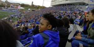 Photo of ThrYve youth attending a KU football game.